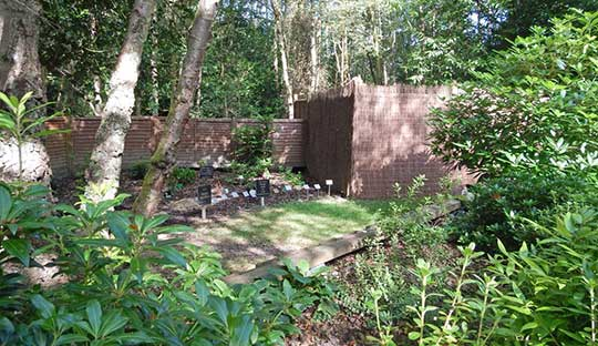 Communal Cremation ashes burial area showing memorial plaques